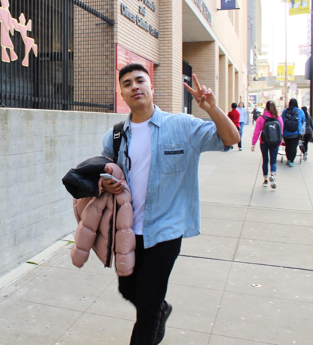 Jonathan De Jesus walking in the street.