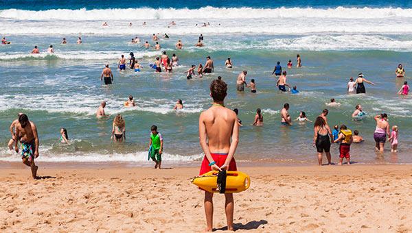 A lifeguard watching a beach.