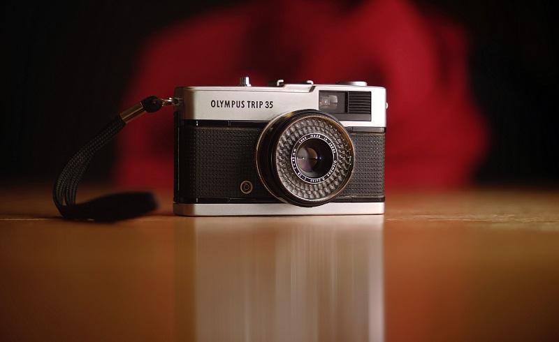 A retro Olympus camera.