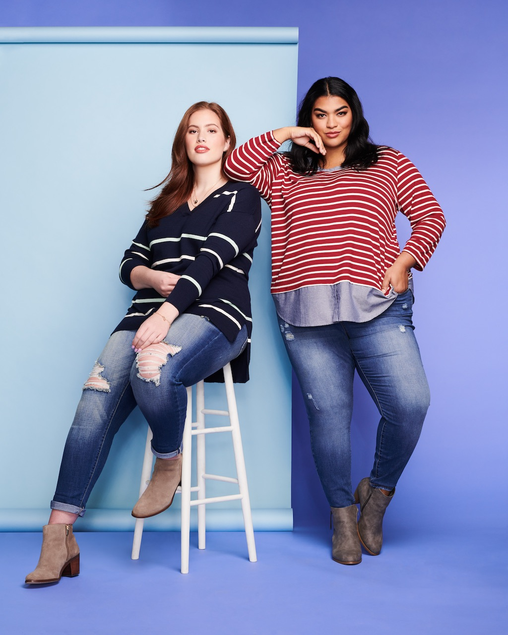 Two plus size models posing.