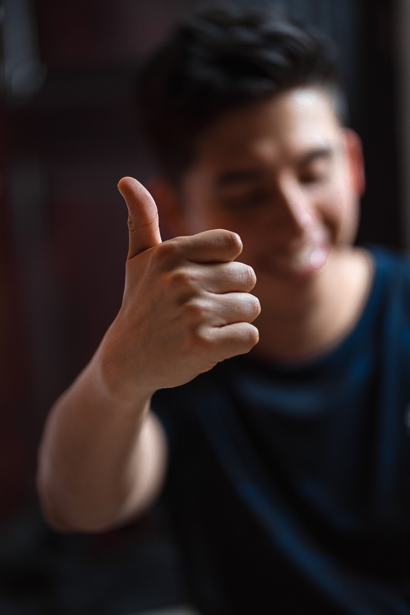 A man holding a thumbs up.