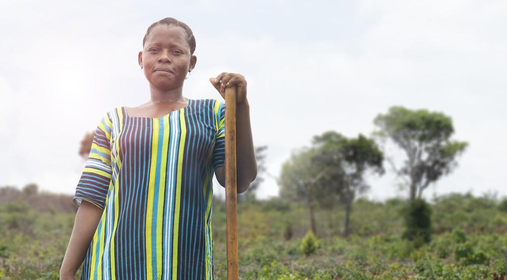 A female worker in a field, taking a break.