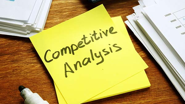 A sticky note that says 'competitive analysis'.