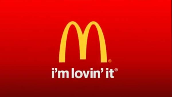 The McDonald's slogan and logo.