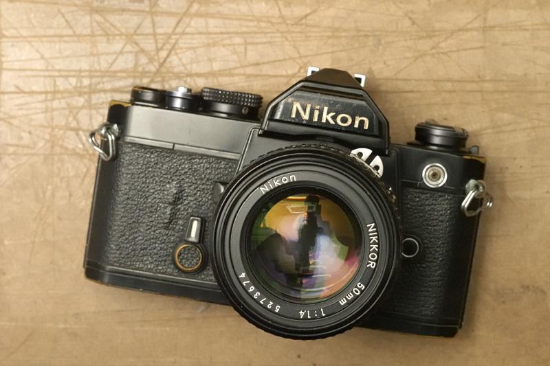 A Nikon camera on a desk.
