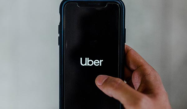 A smartphone with Uber showing.