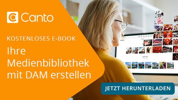 Banner-Link zu einem E-Book, es zeigt eine Frau, die an einem Schreibtisch sitzt und mit dem DAM-System Canto arbeitet.