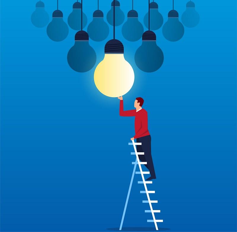 A man on a ladder changing a lightbulb.