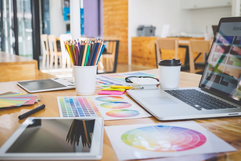 A table filled with design tools.