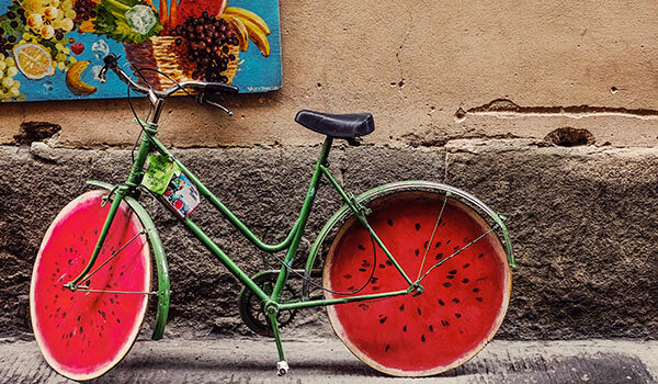 A bicycle with watermelon wheels.
