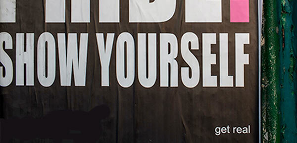A sign that reads, 'show yourself'.