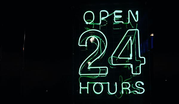 A '24 hours' neon sign.
