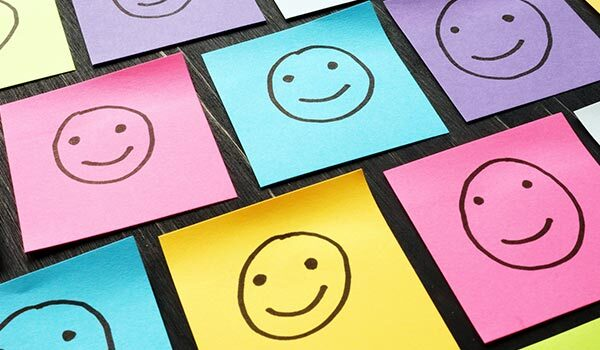 Smiley faces on sticky notes.