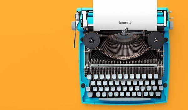A typewriter that says 'honesty'.
