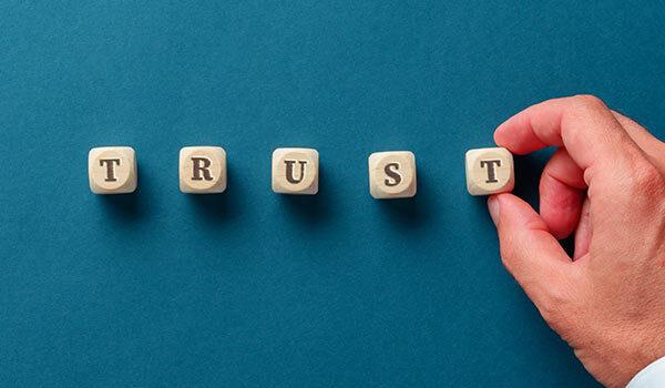 Building blocks that spell, 'trust'.