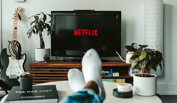 A picture of a person watching Netflix.