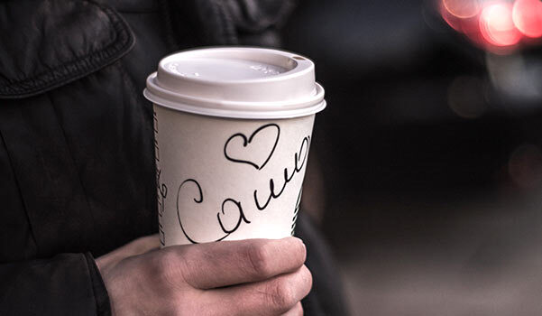 A coffee cup with a person's name on it.