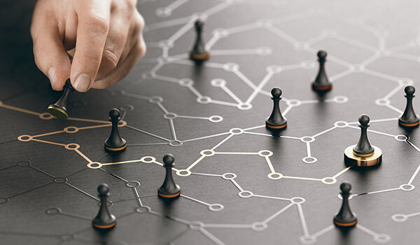 A person moving pawns on a map.
