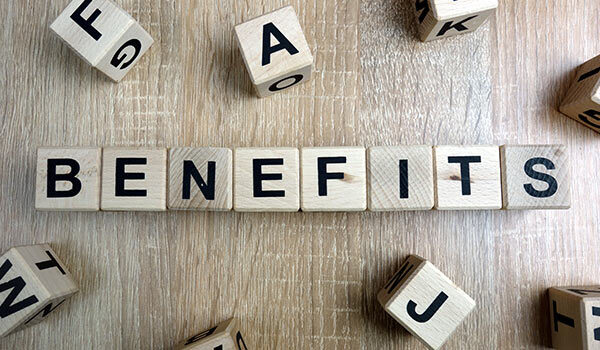 A group of blocks that spell 'benefits'.