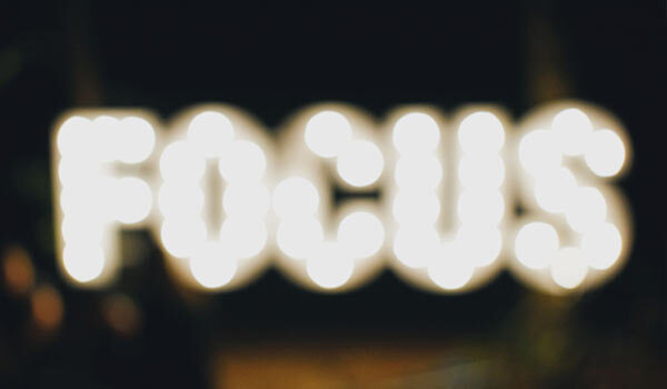 A lighted sign that reads 'focus'.