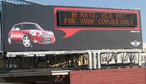 Billboard with digital display addressing driver by name