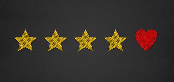Eine Bewertungsleiste mit vier Sternen und einem Herzsymbol.