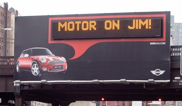 Personalized Mini Cooper billboard with a digital display that reads: Motor on Jim.