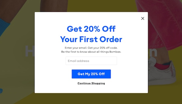 Email sign-up form offering 20% off first order.