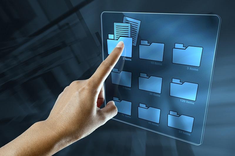 A hand selecting a digital folder.