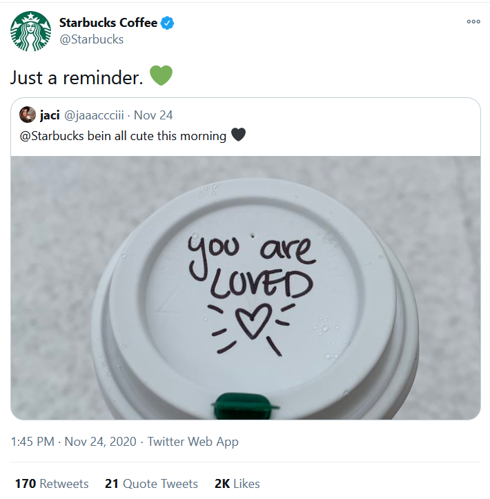 A Starbucks coffee cup lid with writing on it.