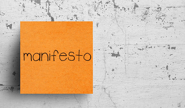 A sticky note that reads 'manifesto'.