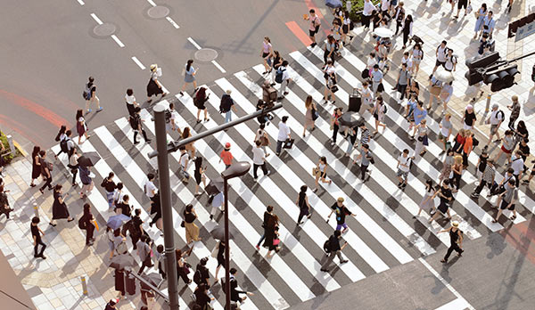 A group of people crossing the street.