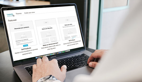 Laptop with email marketing templates on screen.