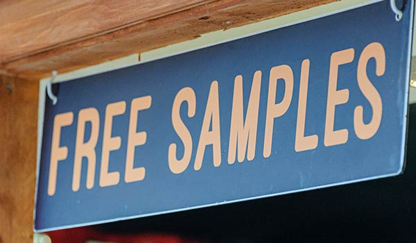 A sign that reads 'free samples'.