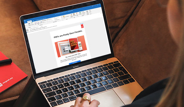 A lead-nurturing email from Adobe on a laptop screen.