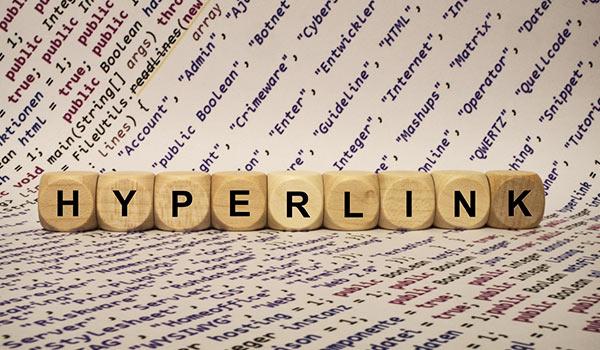 Das Wort 'Hyperlink' wird aus einer Gruppe von Bausteinen gebildet.