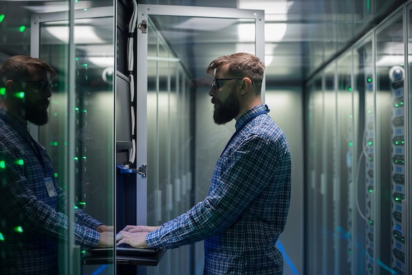 man in front of data storage unit