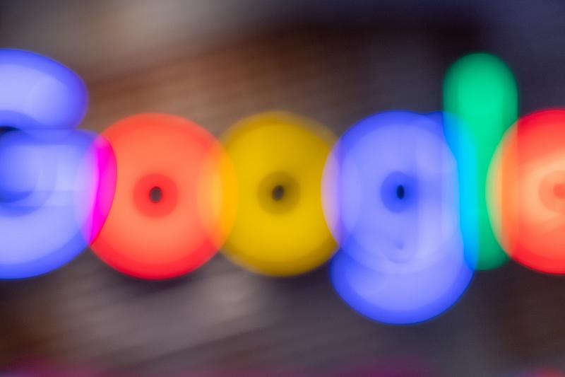 The Google logo blurred.