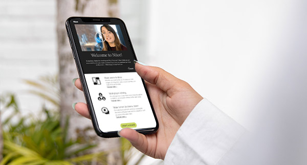 Hand holding a smartphone displaying a video marketing email.