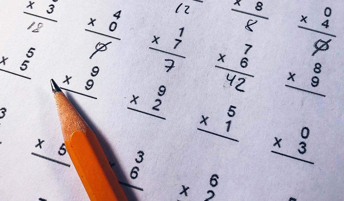 A pencil resting on a math test.