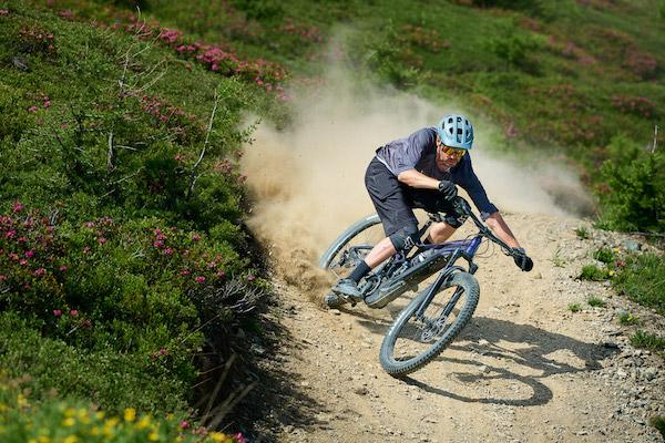 A person riding a bike downhill.
