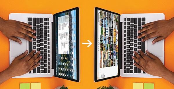 Zwei Laptops, die sich gegenüber stehen und Daten austauschen.