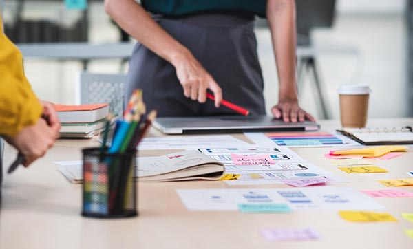 Creative team maps out strategy with colorful paper.