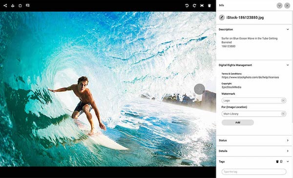 Ein Foto von einem Surfer mit den zugehörigen Informationen zum Digital Rights Management.