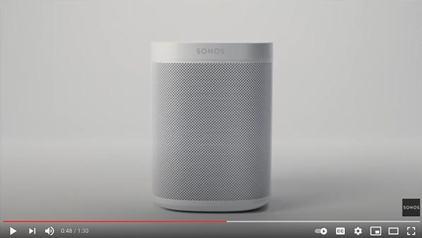 Still from a marketing video featuring the Sonos One on a white background.